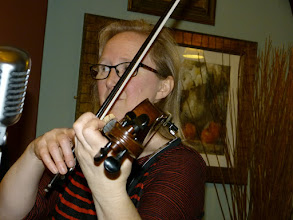 Photo: Close up of Kiri on her fiddle.