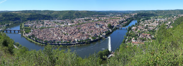 Photo: Panorama of Cahors, situated in an oxbow of the Lot River. The Pont Valentre, its famous medieval bridge, is toward the upper left (below the modern highway viaduct).