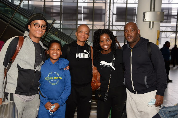 Pitso Mosimane poses for photographs with his wife and kids before flying out of Johannesburg to Cairo on October 1 2020.