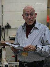 Photo: Incoming Program Chair Mike Colella hands out a survey to get ideas from Members.