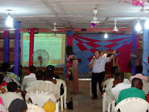 Photo: Pastor Glenn Lauver teaching at the conference.