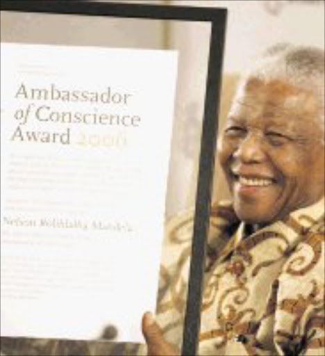 THE MAN: Amnesty International, honouring 'the power of principled leadership and individual activism' bestowed upon South Africa's former president, Nelson Rolihlahla Mandela, its 2006 Ambassador of Conscience award in Johannesburg yesterday. Pic. Lucky Nxumalo. 01/11/2006. © Sowetan.