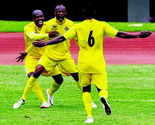 FAMILIAR SIGHT: PSL Footballer of the Season Khama Billiat, centre, celebrates his goal with former-Kaizer Chiefs striker Knowledge Musona as Zimbabwe beat Malawi 3-0 PHOTO: JEKESAI NJIKIZANA/AFP