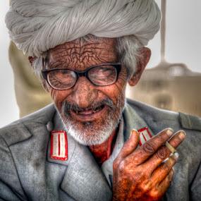 Camel Seller at Pushkar Fair by Aparajita Saha - People Portraits of Men ( wrinkles, bidi, camel, glasses, pushkar, turban, old man )