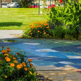 Three Eagle Mosaic  by Julie Wooden - City,  Street & Park  City Parks ( flower garden, north dakota, park, flower beds, landscape, eagles, tiles, nature, bismarck, outdoors, summer, scenery, flowers, mosaic,  )