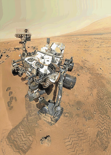 The Curiosity rover uses the Mars Hand Lens Imager to capture a set of thumbnail images stitched together to create a full-colour self-portrait in this image from Nasa.