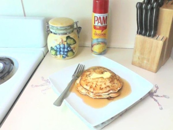 Heat maple syrup in microwave and pour over the pancakes topped with butter.