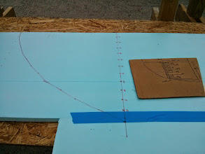 Photo: Transferring measurements from the boat to the board and connecting the dots.