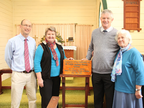 Celebrating 100 years: Reverend Tory Cayzer, Jocelyn Cameron, Bishop of the Diocese of Armidale Rick Lewers and Thalia Phelps with the centenary plaque. Mrs Phelps has given many years of service to the church and Mrs Cameron 30 years as secretary, organist and later warden.