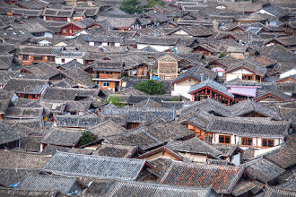 Photo: Rooftops Forever  Here's a view across the top of the village of Lijiang, China. I was really thinking about doing a bit ofAssassin'sCreed action across the top.