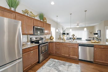 Sophia floorplan kitchen with wood-inspired flooring and stainless steel appliances