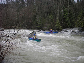 Photo: Pat and Chris on the murky Coquitlam at about 35 m3/s in March rains. These were the biggest eddies on the river. 2007. Photo: Dan Hanna.