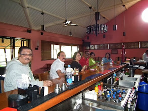 Photo: Trevor Greene, Baba Pujara, Debbie, Thamil, Sheila and Sudha at the bar