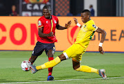 Kaizer Chiefs and Zimbabwe centre-back Teenage Hadebe clears the ball away from Uganda's Patrick Kaddu during their Afcon Group A match at Cairo International Stadium on June 26 2019.