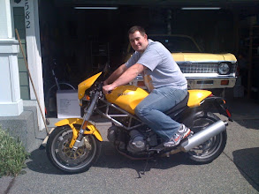 Photo: Andy sitting on the Duc!