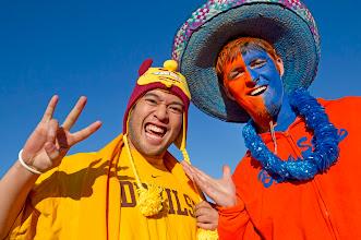 Photo: Arizona State fan Mark DeGarrriz of Glendale, Ariz., and Boise State fan Chad Larsen of Round Mountain, N.V., show their pride during the Maaco Las Vegas Bowl. Photo by Rob Schumacher, The Arizona Republic.