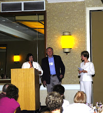 Photo: Marylee Grant Goyan presenting gift to David and Nancy Montgomery Gilmour