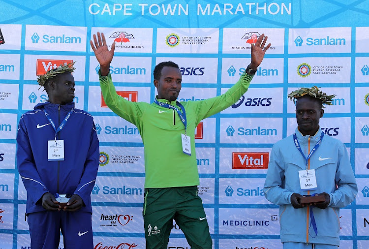 Left to right: Emannuel Tirop, 2nd Place, Asefa Negewo, 1st Place and Baranabas Kiptum, 3rd Place in the Mens Elite Marathon during the 2016 Sanlam Cape Town Marathon in Cape Town on 18 September 2016.