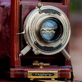 Suset from the lens by Glenn Miller - Artistic Objects Antiques ( reflection, sunset, camera, lens, antique )