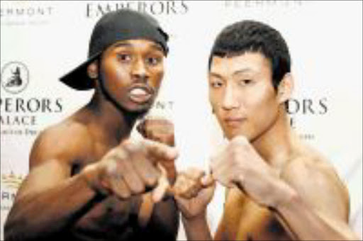 WARRIORS: SA's multiple champion Zolani Marali, left, will fight South Korean Ji Hoon Kim in a 12 rounder for the IBO junior lightweight world title at Emperors Palace on Saturday evening in the