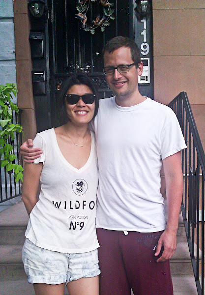 Photo: Dave & Christina in front of their apartment
