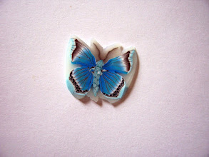 """Photo: Butterfly - 2, Colors: Turquoise, Blue, White, Black and more mixed multicolored butterfly. Very detailed. $6.00 per inch long with a Diameter of 1/2"""" inch, $12.50 per inch long with a Diameter of 3/4"""" and $22.00 per inch long with a Diameter of 1"""" around."""