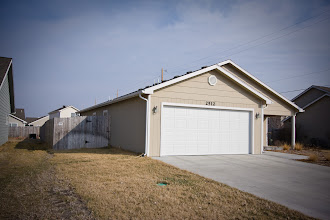 Photo: north side front view of house with 6 foot privacy fence
