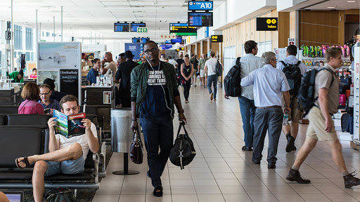 Passengers await their flights at the local departures terminal at Cape Town International Airport.