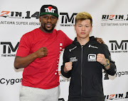 Floyd Mayweather Jr. (L) and Tenshin Nasukawa pose during a news conference at the Mayweather Boxing Club on December 6, 2018 in Las Vegas, Nevada. The two will meet in a three-round boxing exhibition at Saitama Prefecture Super Arena in Saitama, Japan on December 31, 2018.