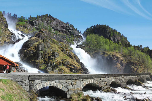 Norway-Latefossen - The spectacular Latefossen waterfall splits apart then comes together before going under the arched bridge. Latefossen is near Oda, Norway, southeast of Bergen.
