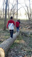 Photo: the boys walking across a log