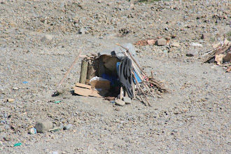 Photo: A shelter (house?) in the riverbed