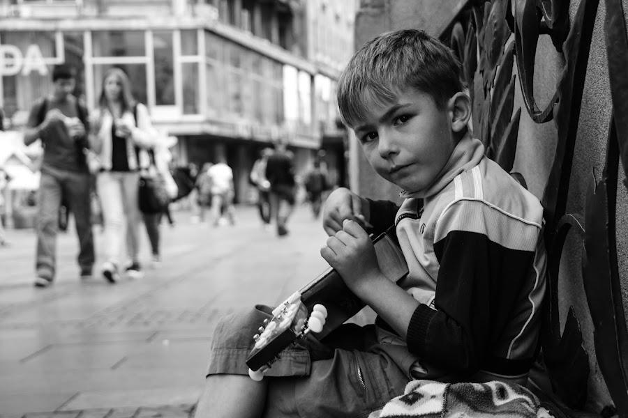 eyes of suffer by Goran Matejin - Babies & Children Children Candids ( child, player, homeless, street, guitar, Emotion, portrait, human, people, , black and white, b&w )