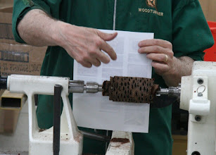 Photo: Here he shows the groove he made for the chuck to grab.  The tenon is the larger dovetail, so...