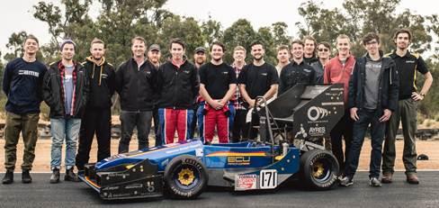 ANSYS | Коллектив «Australian Formula Collective» на фоне разработанного с помощью ANSYS болида команды «ECU Racing» для соревнований Formula SAE
