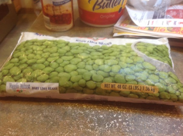 Add the lima beans to the boiling water, and return to a boil, adding...
