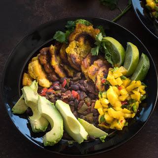 Tropical Buddha Bowls with Plantains, Black Beans, and Mango Salsa.