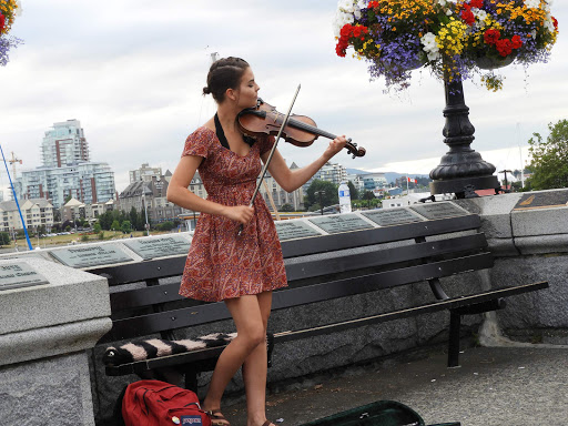 victoria-violinist2.jpg - A violinist performs along the waterfront in Victoria, Canada.