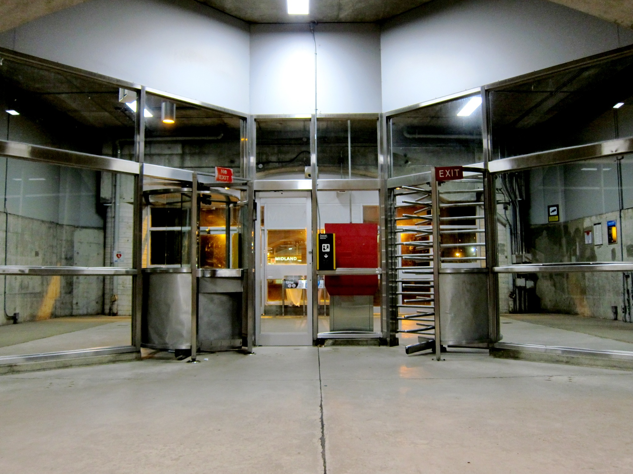 Photo: View of the automated entrance/exit on the eastern side.  This entrance feels like you're standing in a garage.  When the station opened in April 1985, originally there was a closed circuit TV camera at this unstaffed entrance which would allow passengers to display their transfers or Metropasses to the Collector on the west side, who could push a button to let them through the gate.