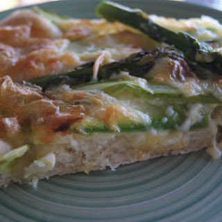 Pizza with Asparagus and Camembert Cheese.