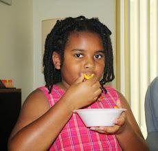Photo: Kaleya eats oranges