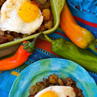 Hatch Chile Potato Hash and Eggs With Chipotle Roasted Tomatoes.