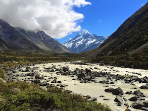 Photo: Looking upstream at the river, Mt. Cook is in the background.