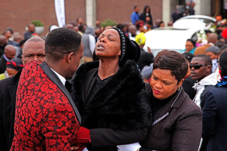 Khensani Maseko's mother Thembi cries at her daughter's funeral at Nasrec Memorial Park, Johannesburg, on August 9, 2018.