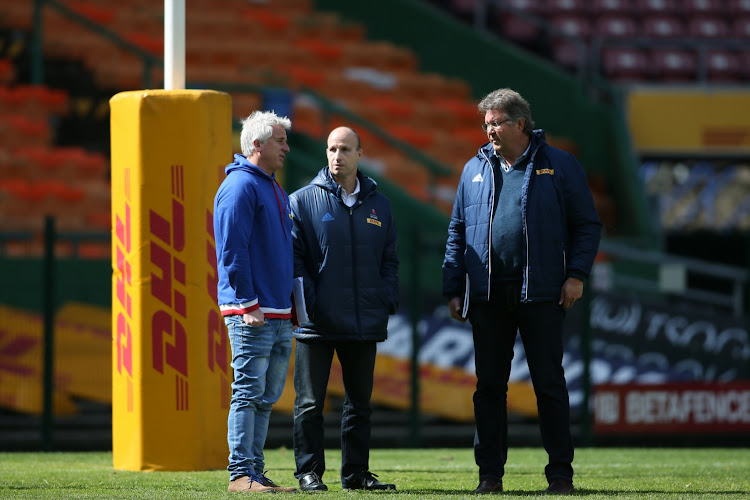 Stormers coach Robbie Fleck (L), Western Province Rugby Group chief executive Paul Zacks (C) and Western Province Director of Rugby Gert Smal (R) during the training session and press conference at DHL Newlands Stadium on August 23, 2018.