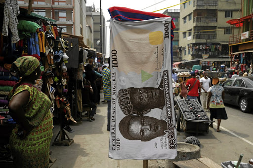 On the money: A towel with a print of the Nigerian naira on display for sale at a street market in the central business district in Lagos. Picture: REUTERS