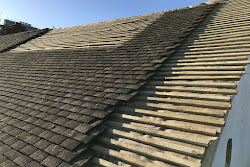 A roof in the process of being tiled