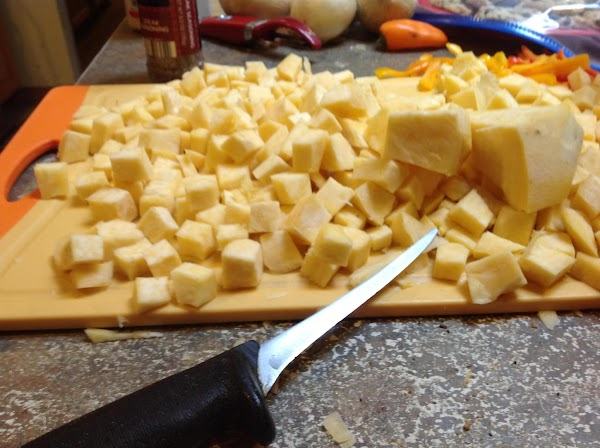 Now using a very sharp knife, cube each small piece, then chop the onions.