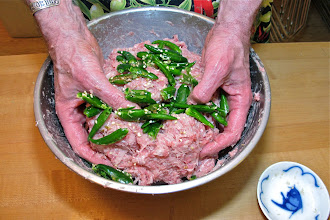 Photo: adding the crushed green Thai chillies