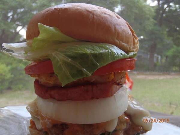 When everything is done and burgers assembled apply a generous amount of dressing to...